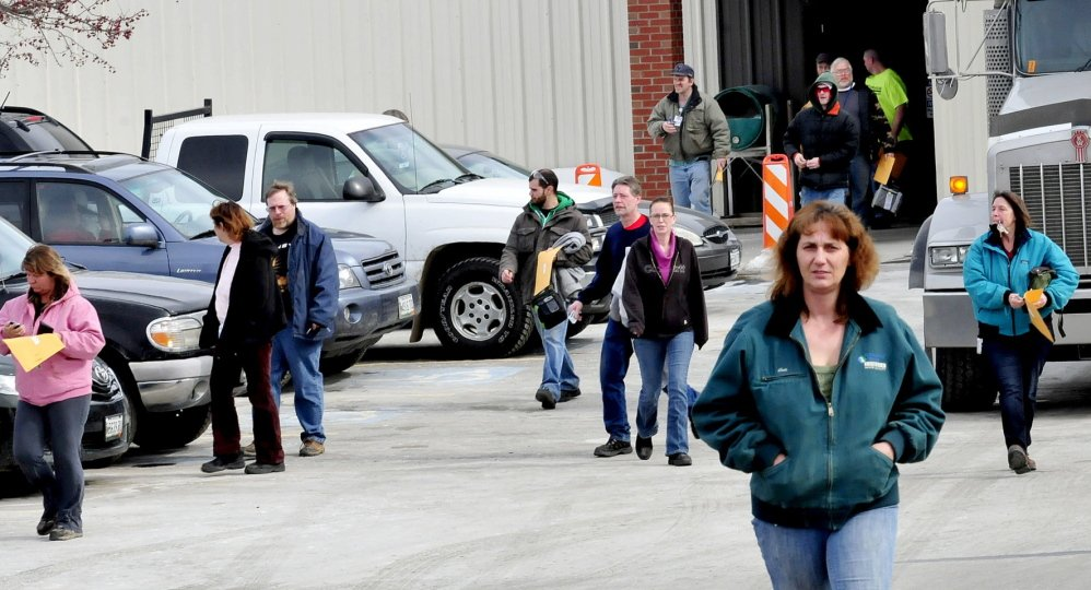 Employees leave United Technologies Corp. Fire & Security company in Pittsfield on Wednesday. The company announced Tuesday it will close in a year. Employees interviewed Wednesday said that they did not see the announcement coming and the mood of workers was subdued.