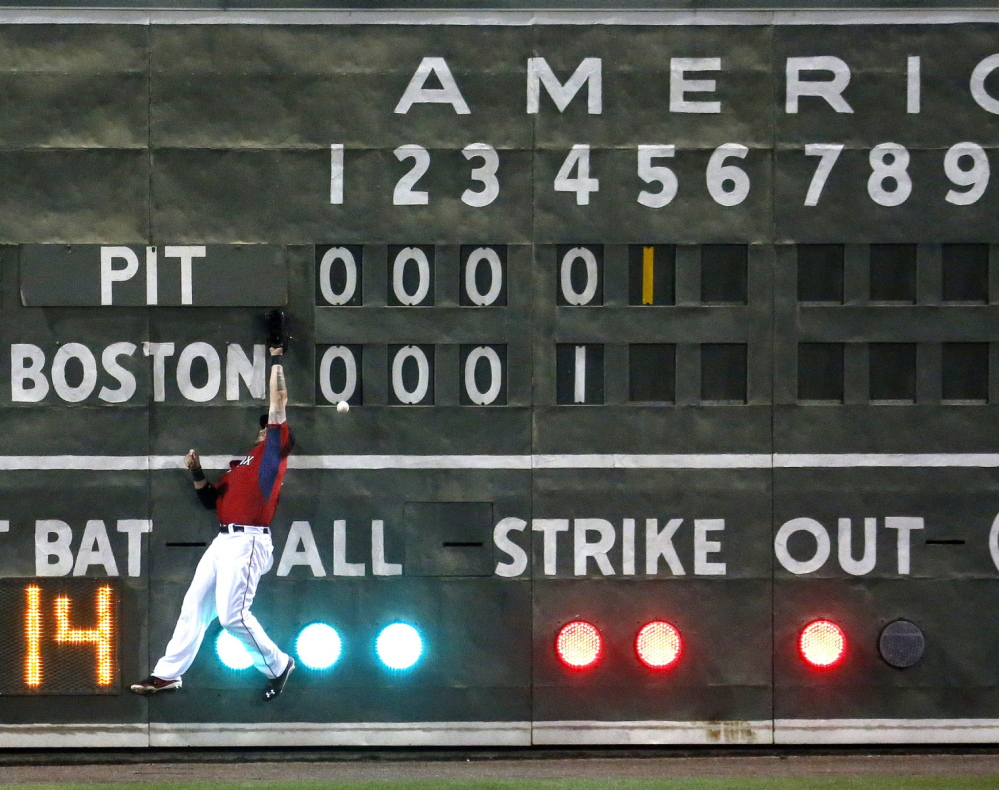 It was a crash landing Wednesday night for Jonny Gomes of the Boston Red Sox, who made contact with the left-field scoreboard at Fort Myers, Fla. – the one that looks just like the one in Fenway Park – in an attempt to catch a fly ball.