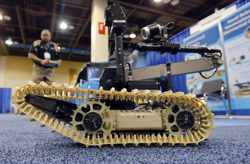 Steven Roberson, of QinetiQ, demonstrates a robotic system at the Border Security Expo in Phoenix.