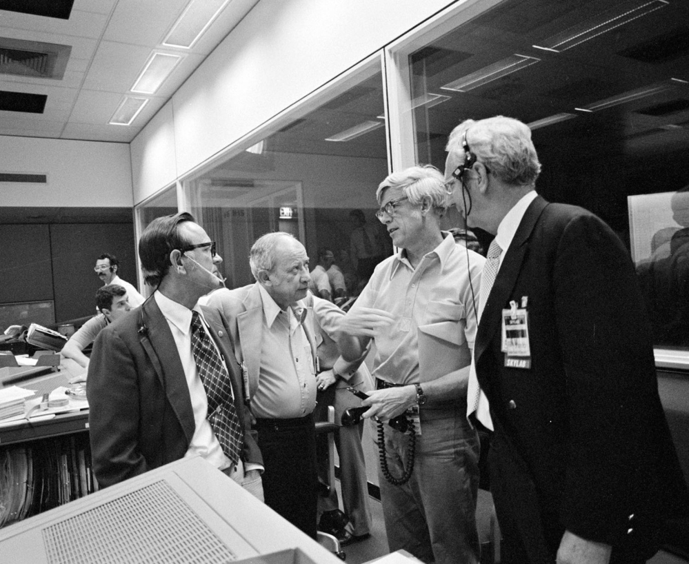 """Jack Kinzler, second from right, seen in June 1973 with other NASA officials in Houston, was known as """"Mr. Fix-it"""" in the agency for his ability to find solutions to unexpected problems. He died March 4 at 94."""