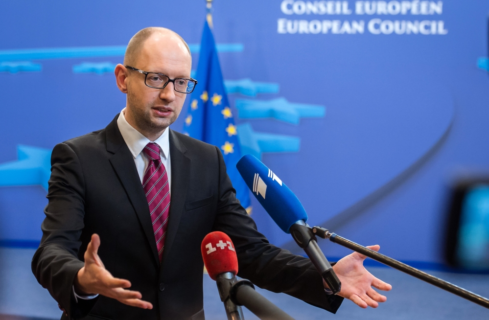 Ukrainian Prime Minister Arseniy Yatsenyuk speaks with the media after a signing ceremony at an EU summit in Brussels on Friday, March 21, 2014. Ukraine's prime minister has pulled his nation closer into Europe's orbit, signing a political association agreement with the EU at a summit of the bloc's leaders. Friday's agreement between Prime Minister Arseniy Yatsenyuk and the EU leaders was part of the pact that former President Viktor Yanukovych backed out of last November in favor of a $15 billion bailout from Russia. That decision sparked the protests that ultimately led to his downfall and flight last month, setting off one of Europe's worst political crises since the Cold War.