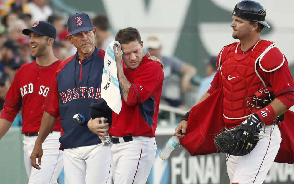It's team unity from the start as pitcher Jake Peavy gets a hand from Coach Juan Nieves while catcher A.J. Pierzynski and a teammate join in proceeding from the bullpen to the dugout before an exhibition game against Pittsburgh at Fort Myers, Fla.