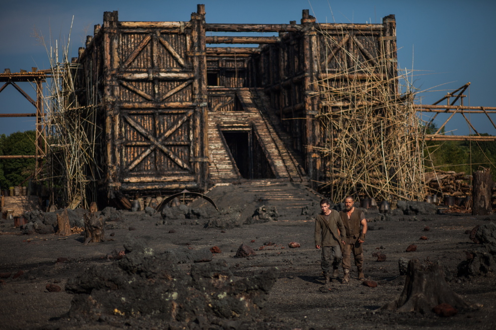 """Logan Lerman, left, and Russell Crowe in a scene from """"Noah."""" The movie has sparked controversy among some conservative Christians in the U.S., who object to its interpretation of the Bible story, and among some Muslims who say it contradicts a generally agreed upon taboo in Islam by depicting a prophet."""