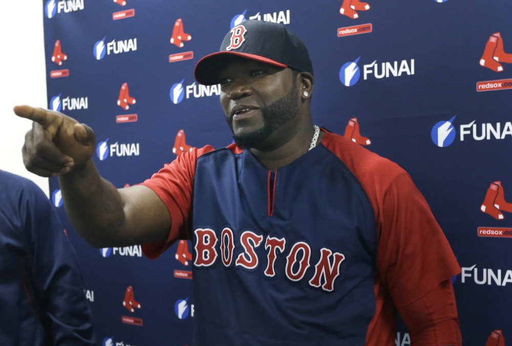 Boston Red Sox designated hitter David Ortiz gestures during a news conference regarding an agreement reached with the team that all but assures the popular slugger will finish his career in Boston, Monday.