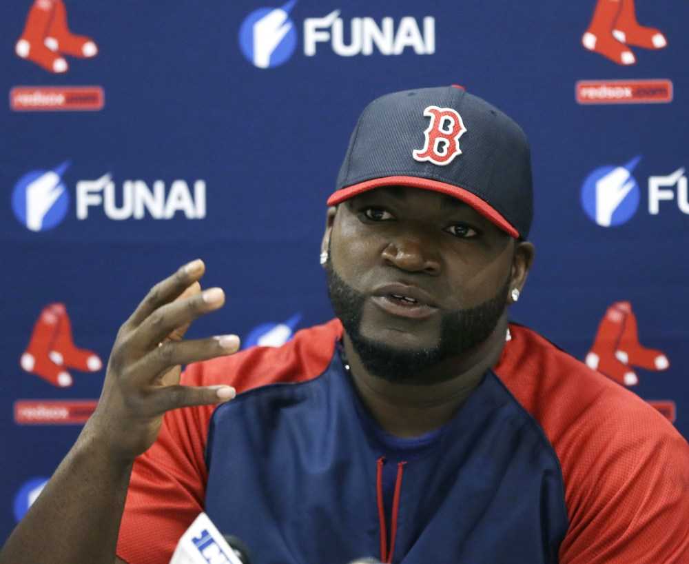 Boston slugger David Ortiz talks to the media Monday in Sarasota, Fla., after signing a new contract with the team.