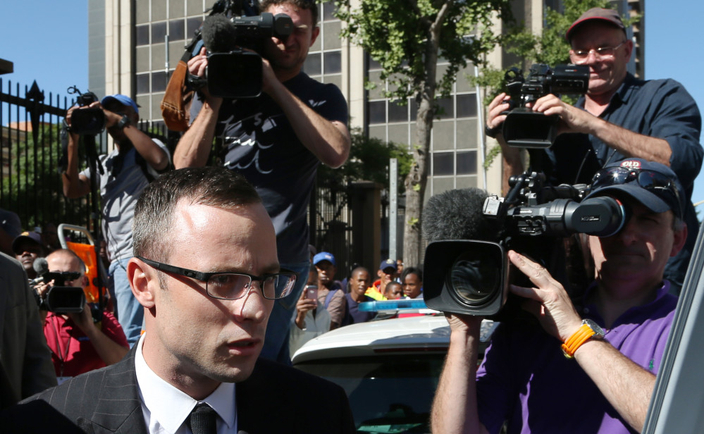 Oscar Pistorius leaves the high court in Pretoria, South Africa, Tuesday.