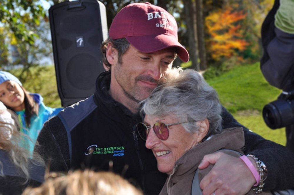 Patrick Dempsey hugs his mother, Amanda Dempsey, a cancer survivor whose struggle inspired her son to establish The Patrick Dempsey Center for Cancer Hope & Healing in Lewiston.