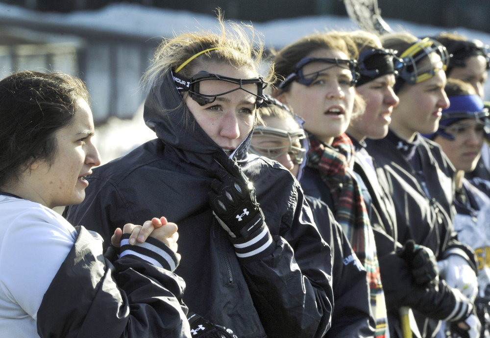 They play for the love of the game. Something to remind themselves Tuesday as the University of Southern Maine withstood the cold to win its women's lacrosse home opener. Kim Vogel, left, and Kaelyn Kuni, second left, were among those trying to avoid frostbite.