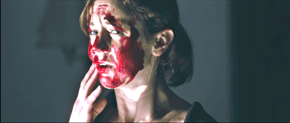 """Casey Turner is bloodied in a scene from """"The Hanover House."""""""