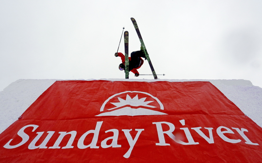 A skier crests the top of the first big jump at the 6th annual Dumont Cup at Sunday River Ski Resort in Newry on Friday.