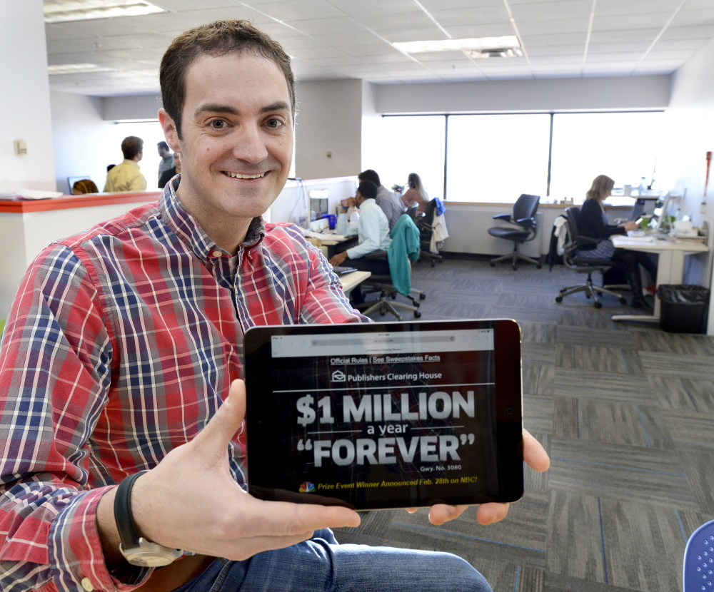 Jason Cianchette, founder of Liquid Wireless, displays an app his company created. He moved his company from Boston to Portland because he wanted to live in Maine.