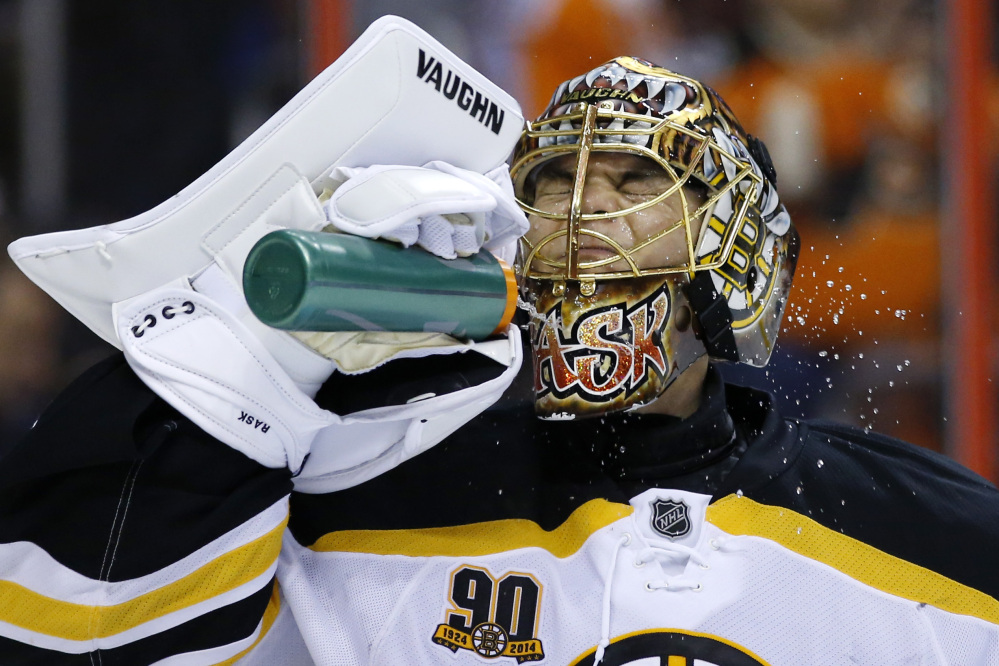 Bruins goalie Tuukka Rask cools off during a break in the second period of Sunday's game at Philadelphia. The Bruins won 4-3 in a shootout,