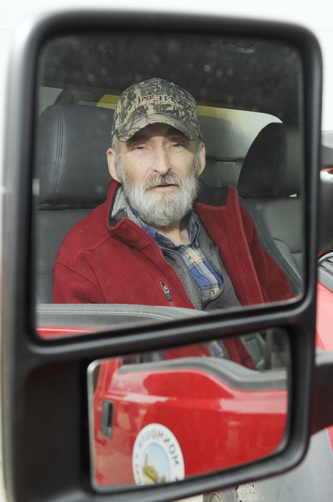 Leonard Crocker, sitting in a Monmouth Public Works truck on Friday at the town garage, says he would like to find the woman who apparently helped save his life March 17 in Monmouth after he had a heart attack and collapsed on a road while working.