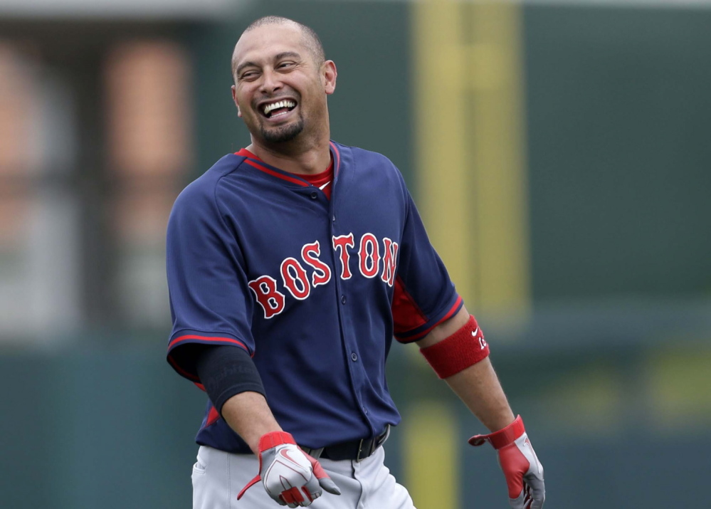 Boston Red Sox right fielder Shane Victorino may miss Monday's opener with an injured right hamstring, He returned to Boston on Sunday to have it examined.