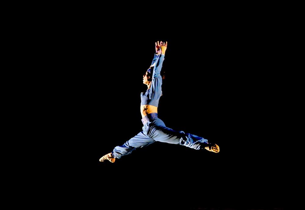 """Junichi Fukuda leaps across the stage during the Portland Ballet performance of """"Bolero to Bayadere"""" at the Westbrook Performing Arts Center on Saturday."""