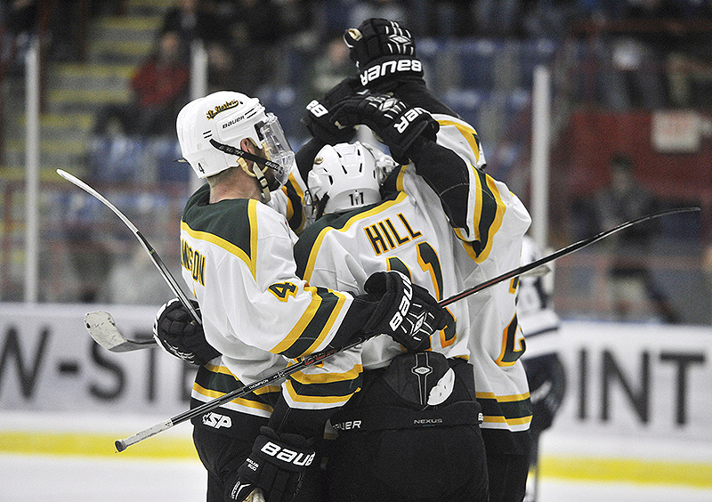 Michael Hill of St. Norbert celebrates with teammates Friday after giving the Green Knights a 3-2 lead on the way to a 6-2 victory against SUNY-Geneseo in the Division III semifinals at Lewiston. St. Norbert will meet Wisconsin-Stevens point in the final.