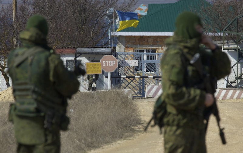 Pro-Russian soldiers block the Ukrainian naval base in the village of Novoozerne, some 91 kilometers west of Crimean capital Simferopol, Ukraine, on March 3. Ukraine announced plans Wednesday for mass troop withdrawals from the strategic peninsula.