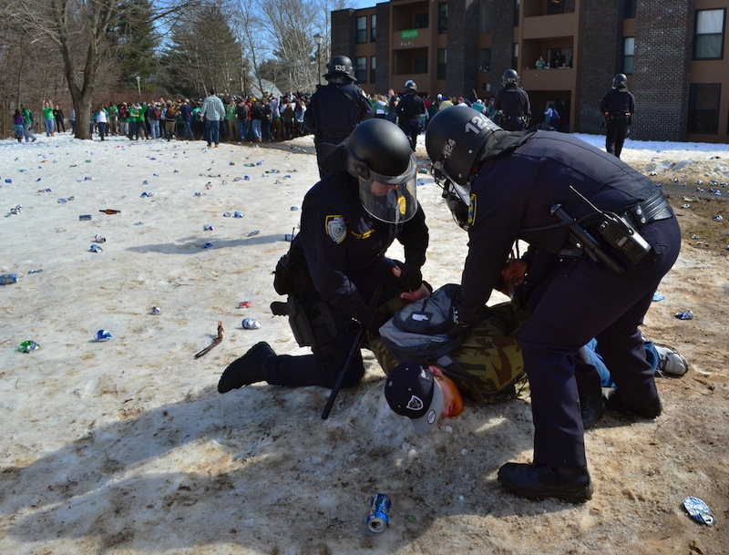 Police detain a participant in the pre-St. Patrick's Day