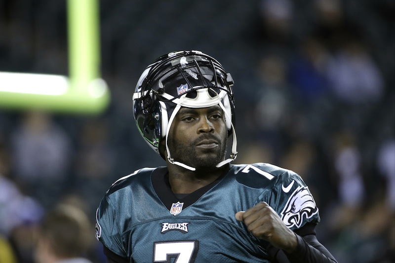 In a Dec. 22, 2013 file photo, Philadelphia Eagles' Michael Vick warms up before the first half of an NFL football game between the Philadelphia Eagles and the Chicago Bears, in Philadelphia. The New York Jets signed quarterback Michael Vick and released Mark Sanchez on Friday, March 21, 2014. Vick was a free agent after spending the last five seasons with the Phialdelphia Eagles.