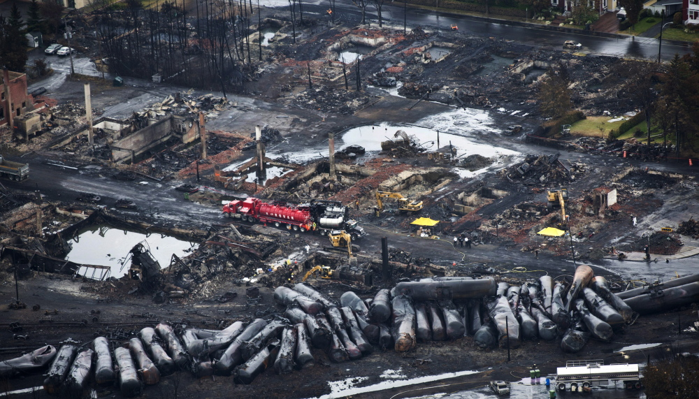 Crews comb through debris after an oil train derailed and exploded in the town of Lac-Megantic, Quebec, last July, killing 47 people.