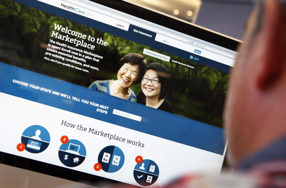 A man looks over the Affordable Care Act (commonly known as Obamacare) sign-up page on the HealthCare.gov website in New York in this October 2013 photo illustration.