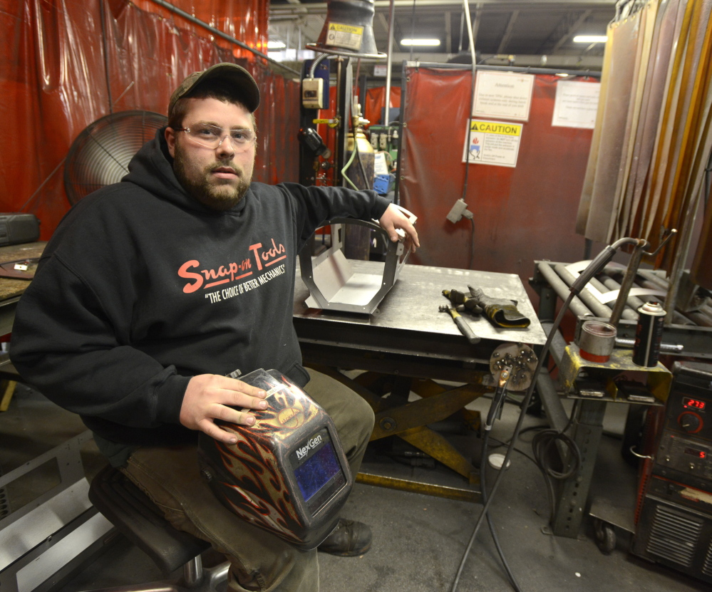 Ryan Villineau is a welder at the Jotul factory in Gorham. He completed a one-year certificate program at SMCC.