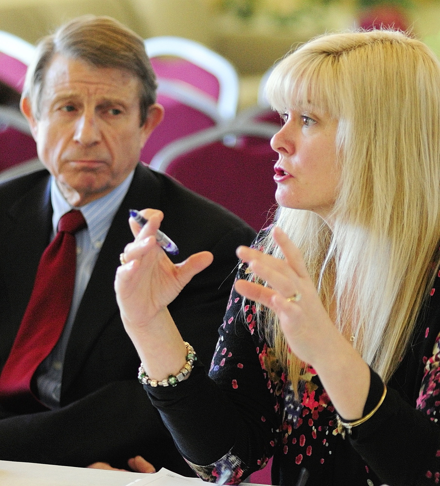 Maine Virtual Academy board secretary Peter Mills, left, listens as board chairwoman Amy Carlisle answers a question from the state Charter School Commission in February during an interview at University of Maine at Augusta.