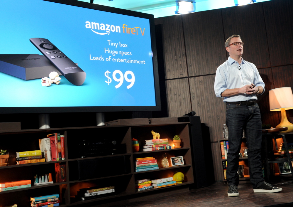 Peter Larsen introduces Amazon Fire TV in New York on Wednesday. The device offers Netflix, Hulu and other streaming channels in addition to Amazon Prime instant video.