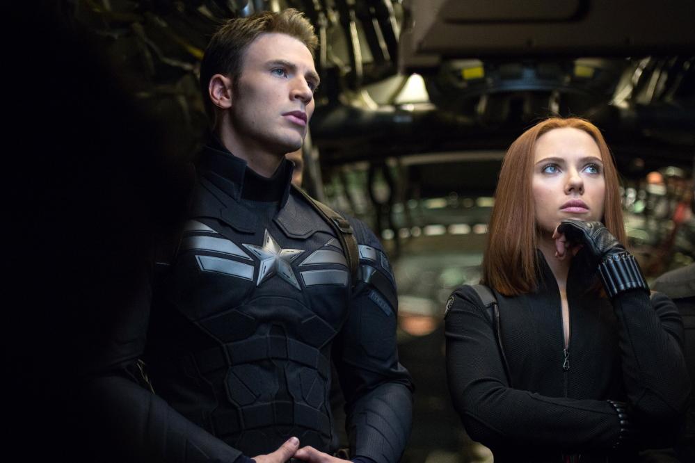 "Chris Evans is Steve Rogers, aka Captain America, and Scarlett Johansson is Natasha Romanoff, aka the Black Widow, in ""Captain America: The Winter Soldier."""