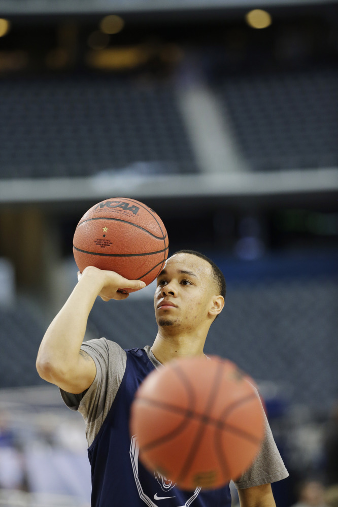 Connecticut guard Shabazz Napier drills during team practice for an NCAA Final Four tournament college basketball semifinal game Friday, April 4, 2014, in Dallas. Connecticut plays Florida on Saturday, April 5, 2014. (AP Photo/David J. Phillip)