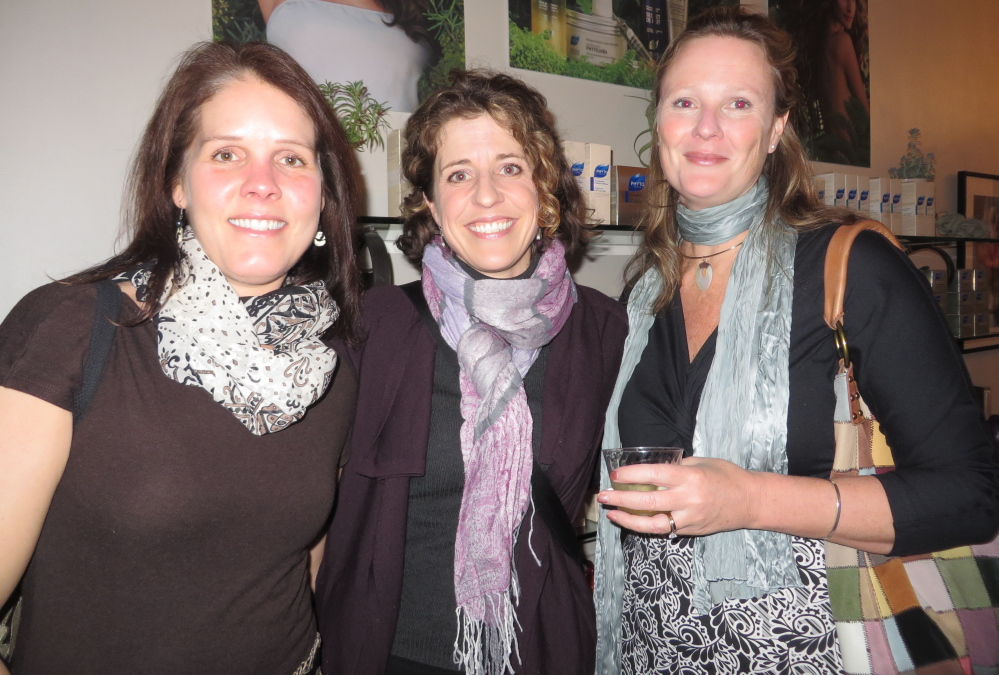 Biz Brewer, Ashley Wernher-Collins and Claire Depke, all of Cape Elizabeth, at the opening reception.