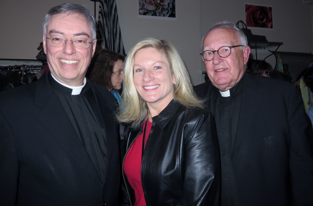 """Father Marc Caron with Deb Coppinger, parish secretary at Parish of the Holy Eucharist in Yarmouth, and Monsignor Charles Murphy at the Maine Jewish Film Festival opening reception before the showing of """"The Jewish Cardinal"""" at the Nickelodeon."""