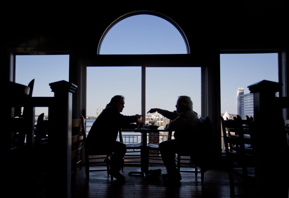 Two patrons enjoy dinner with a view at Joe's Boathouse in South Portland.