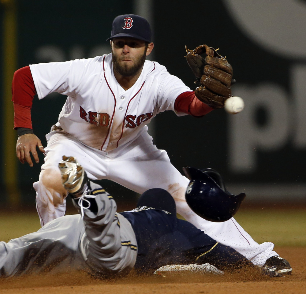Boston second baseman Dustin Pedroia can't get to the throw from catcher A.J. Pierzynski as Milwaukee's Jean Segura steals second base during the eighth inning.