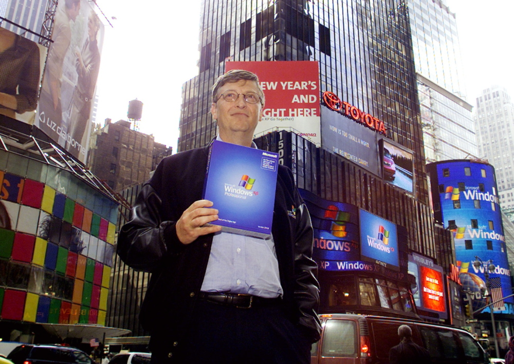 Bill Gates, chairman and chief software architect of Microsoft, holds a copy of Microsoft's Windows XP in New York's Times Square in 2001.