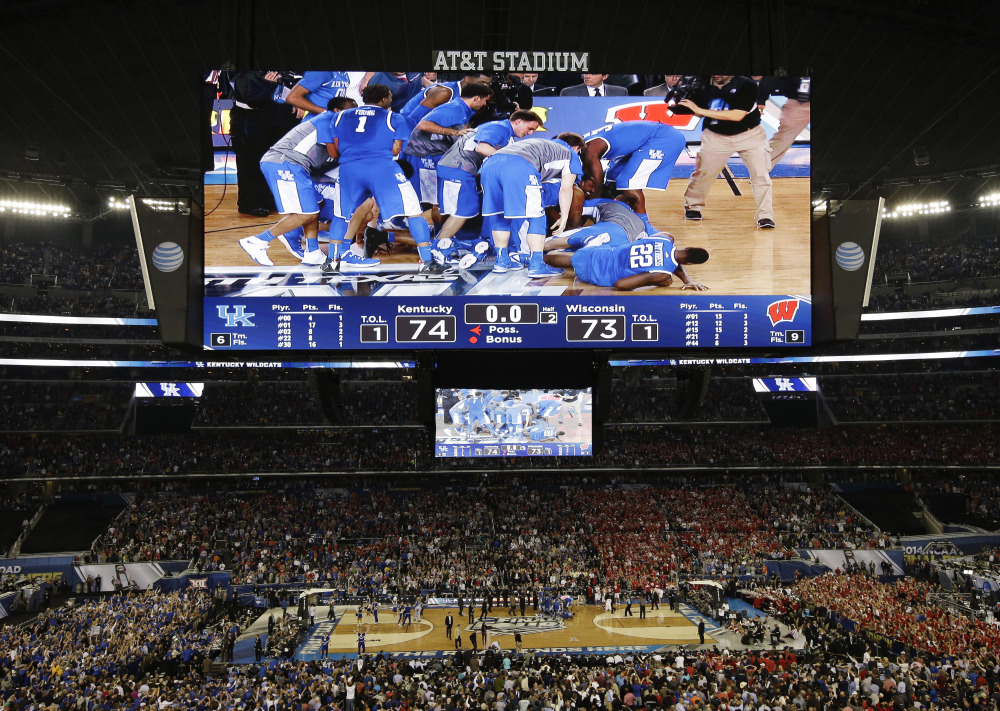 Kentucky celebrates after guard Aaron Harrison made a three-point basket in the final seconds against Wisconsin to win the game 74-73 during their NCAA Final Four semifinal game Saturday.