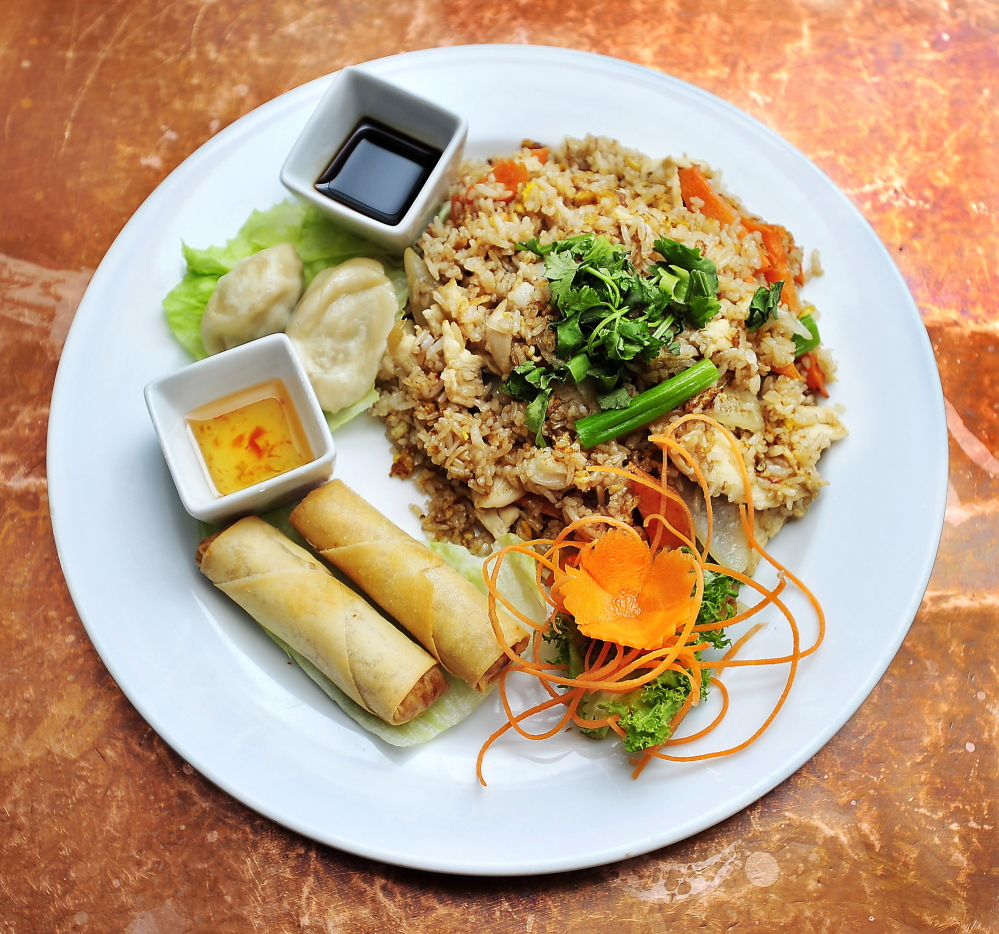 The Thai fried rice lunch special at Chaba Thai Cuisine, with chicken, egg, carrot, onion and scallion, with sides of dumplings and vegetable egg rolls.