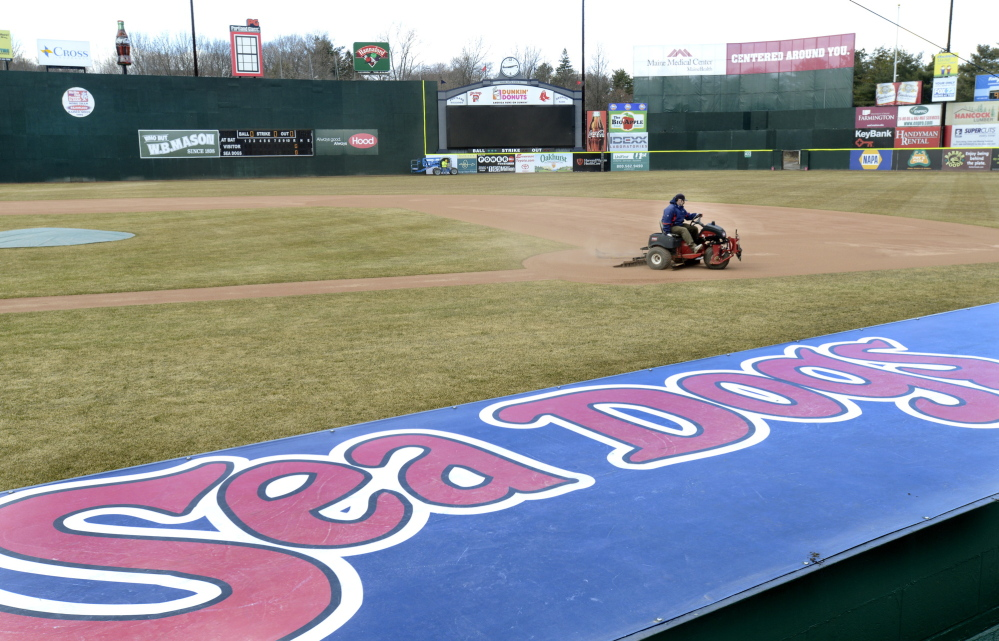 Jason Cooke, of the Sea Dogs grounds crew, works Hadlock Field on Wednesday in anticipation of today's home opener against the New Britain Rock Cats. Opening ceremonies begin at 5:50 p.m. and the game starts half an hour later.