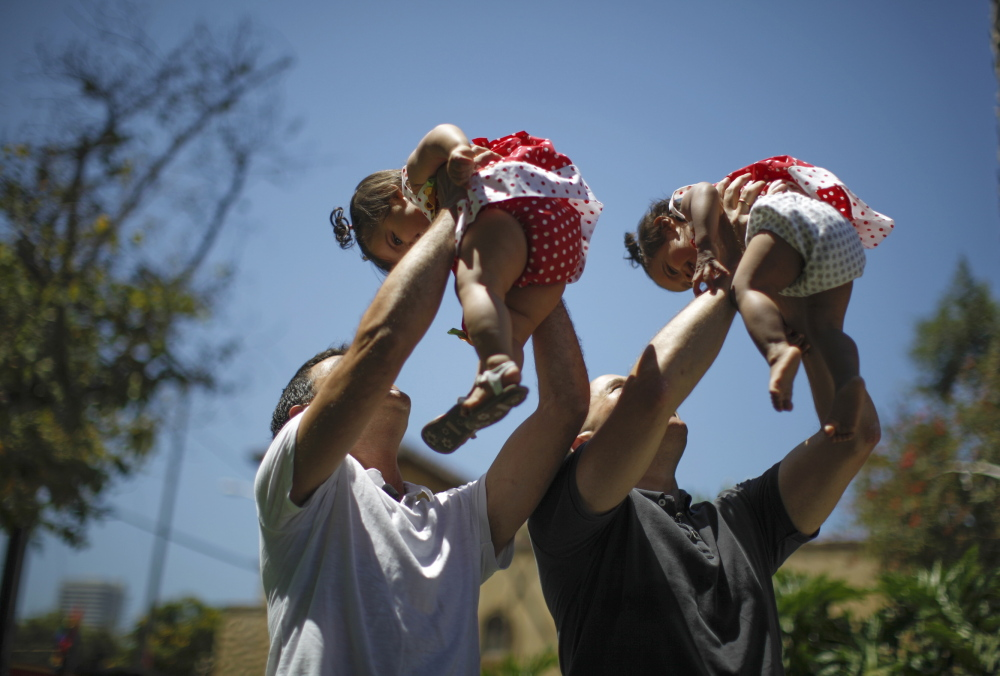 Jason Howe, 48, and Adrian Perez, left, 48, who were married in California, hold their 1-year-old twin daughters at a playground last year as legal momentum was building across the country in favor of same-sex marriage. An appeals court in Denver will hear a case Thursday that could have a major impact on whether that momentum can continue.
