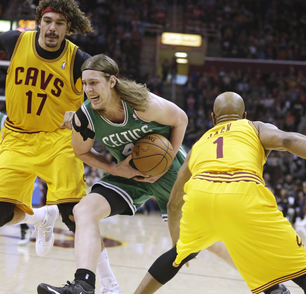 Boston's Kelly Olynyk tries to keep a handle on the ball as he drives between Cleveland's Anderson Varejao, left, and Jarrett Jack during the Celtics' win Saturday at Cleveland.