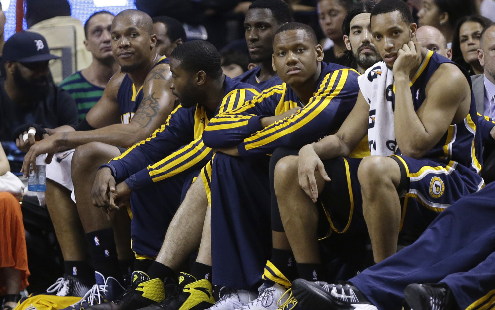 David West, left, of the Indiana Pacers sits on the bench after fouling out in the second half of a 98-86 loss to the Miami Heat on Friday. The game had been anticipated as a battle between two top NBA teams, but Indiana again fell prey to a mediocre performance.
