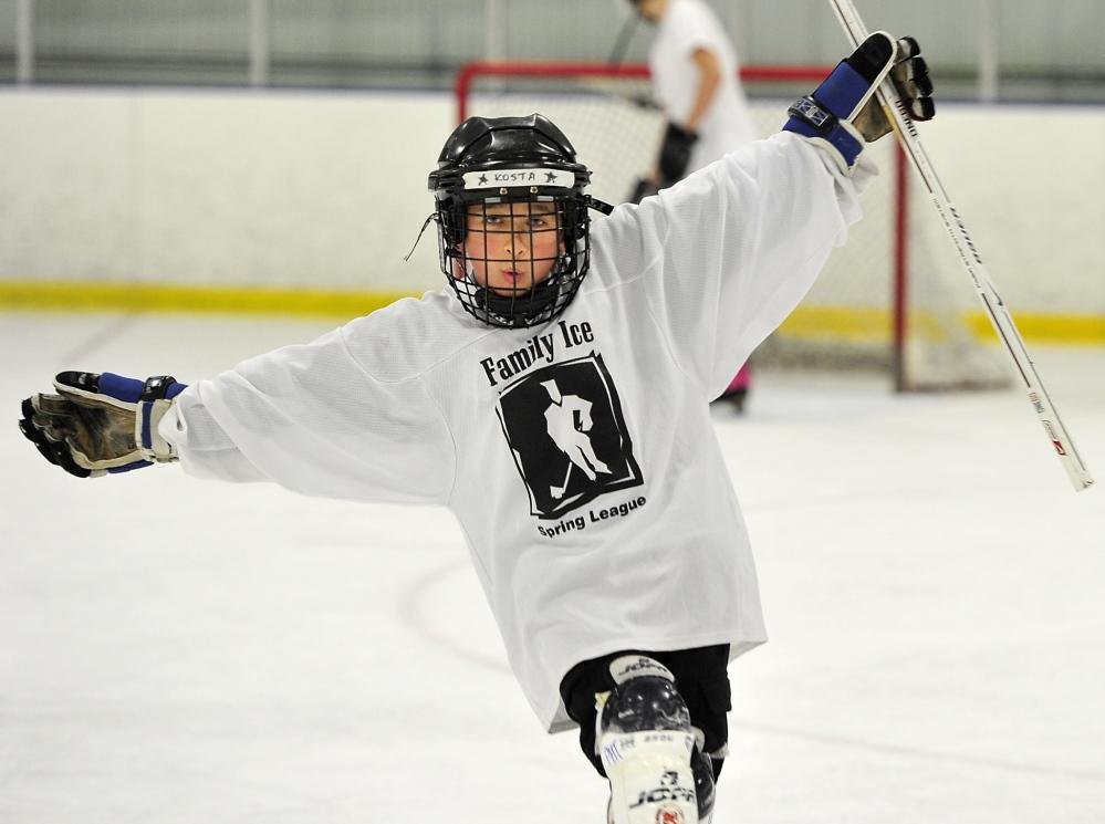 Kosta Nedeljkovic celebrates his goal during a scrimmage in the Portland Hockey Trust program at Portland Ice Arena.