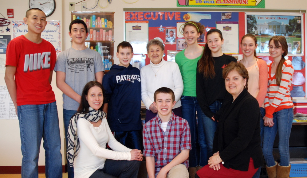 Members of the Wells Junior High School Newspaper Club donated $225 to the St. Mary's Food Pantry. Pictured (back row, from left) are Channing Wang, Nolan Potter, Kyle Crothers, Pantry Director Elinor Grover, Megan Schneider, Olivia Durfee, Madison Szczygiel, Paige Raymond and, front row center, Christian Saulnier. Flanking Saulnier are teachers Julie Esch and Marilyn Zotos.