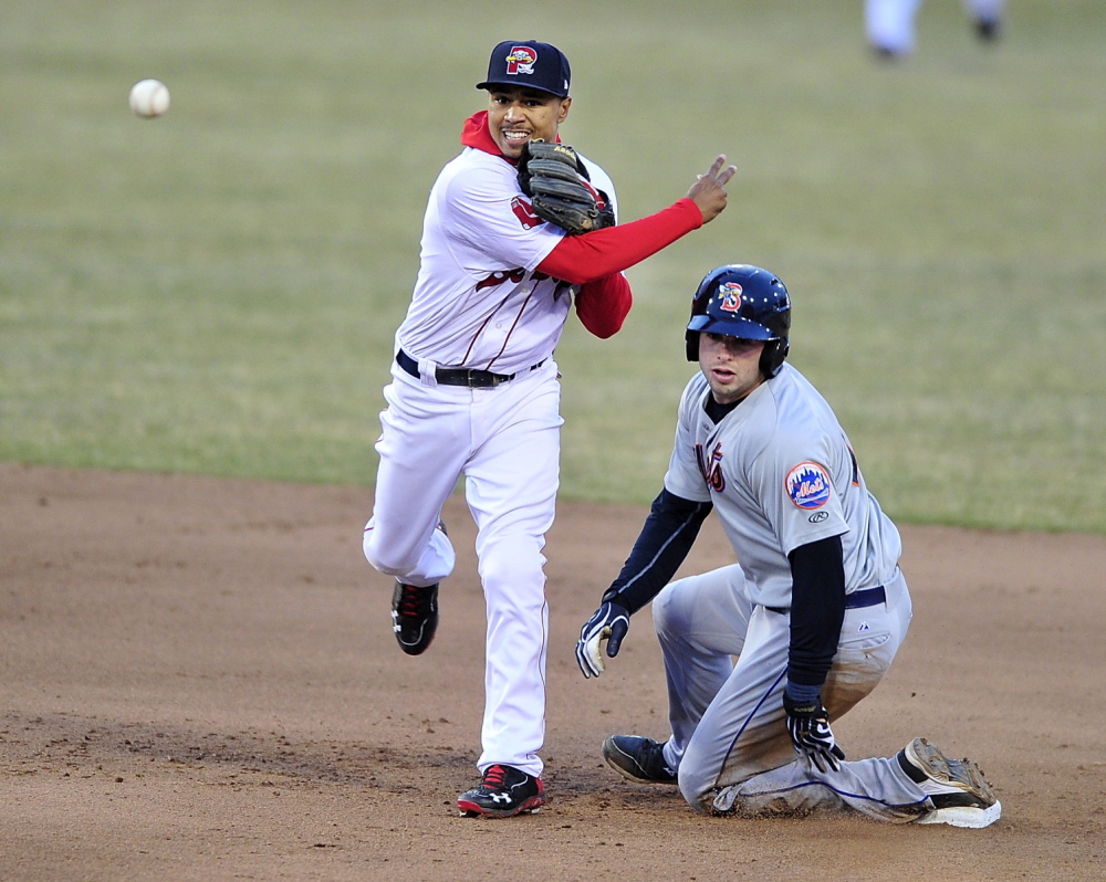 Sea Dogs second baseman Mookie Betts fires to first to complete the double play as Binghamton's Kevin Plawecki watches.