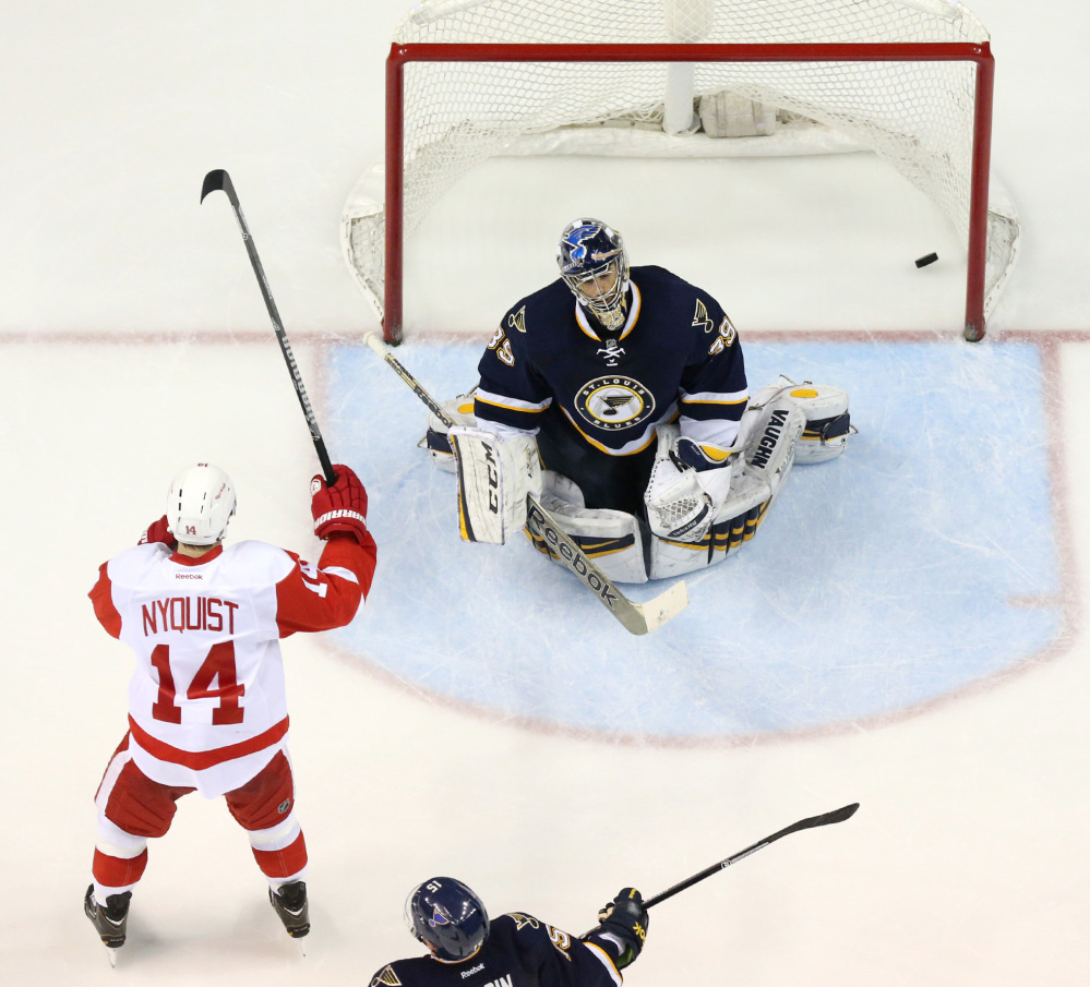 Detroit's Gustav Nyquist, left, raises his stick after teammate Justin Abdelkader scored against St. Louis Blues goaltender Ryan Miller during the third period of Detroit's 3-0 win at St. Louis on Sunday. Nyquist and Abdelkader powered a charge into the playoffs.