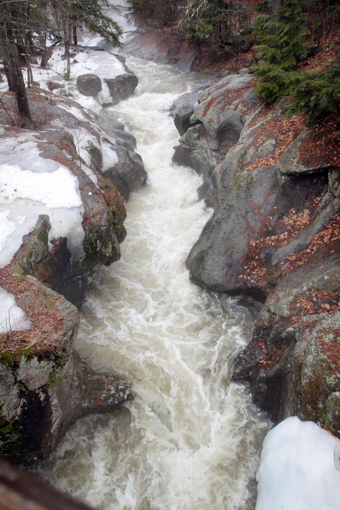 Water from melting snow and rain flow down the Cockermouth River through Sculpture Rocks in Groton, N.H., on Tuesday. Concerns about flooding in northern New England grew Tuesday as more rain comes to the region.