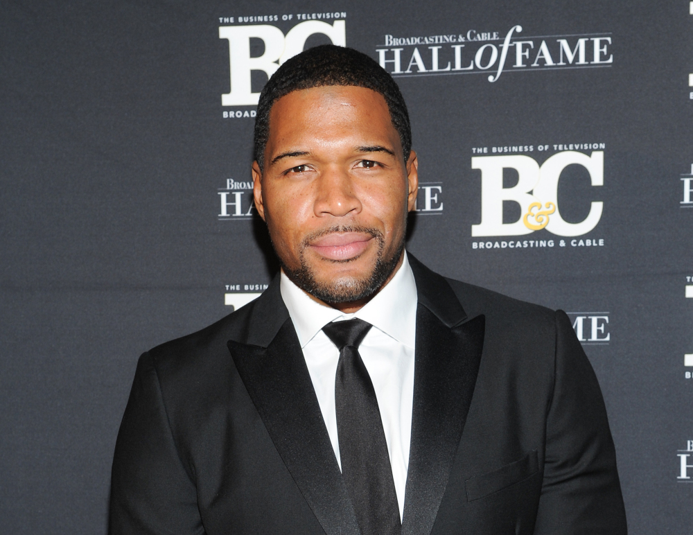 """The Associated Press This Oct. 28, 2013 file photo shows former professional football player Michael Strahan, co-host of """"Live with Kelly and Michael,"""" attending the 23rd Annual Broadcasting & Cable Hall of Fame Awards in New York."""