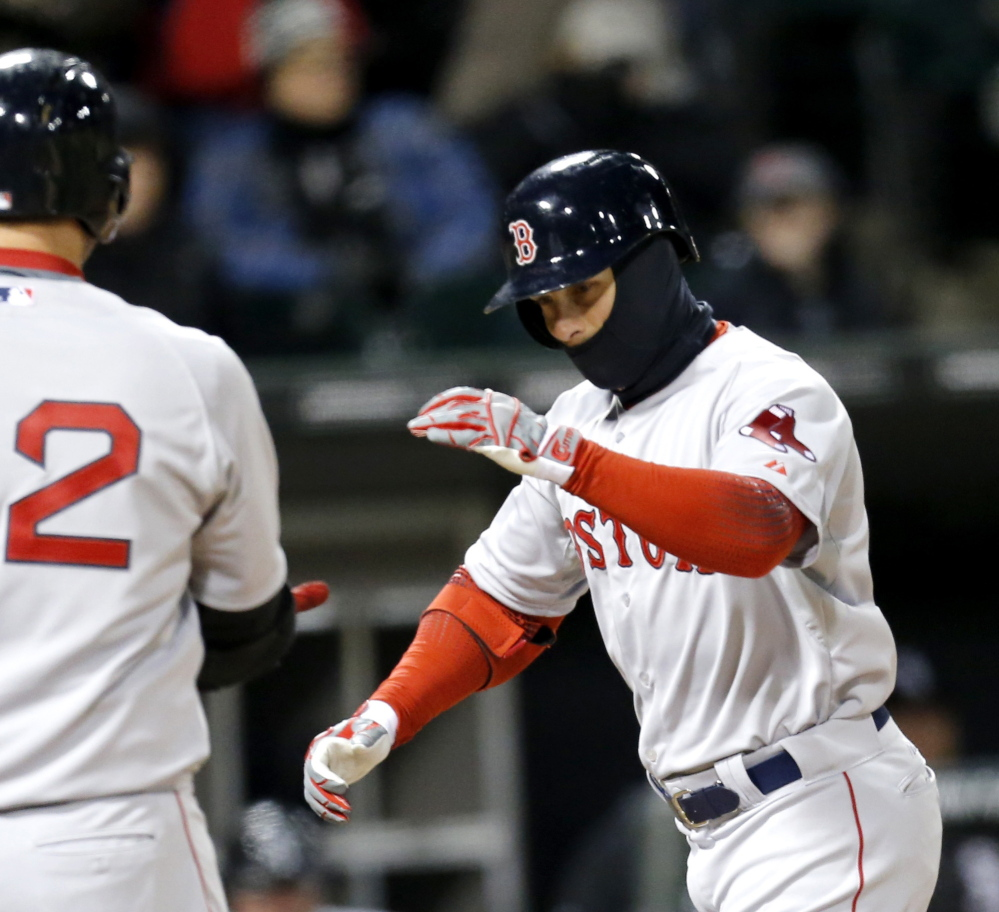 Daniel Nava of the Boston Red Sox, right, celebrates Tuesday night after hitting a home run against the Chicago White Sox.
