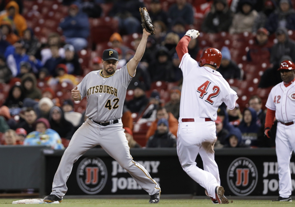 There were plenty of players wearing No. 42 in the major leagues Tuesday night, including Gaby Sanchez of Pittsburgh, left, and Devin Mesoraco of Cincinnati. In fact all the players wore No. 42, to honor the accomplishments of Jackie Robinson.