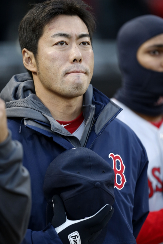 Red Sox relief pitcher Koji Uehara pauses during the pre-game Boston Marathon tribute.